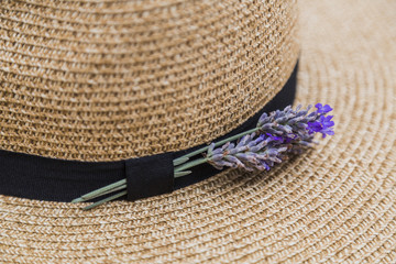 Lavender inserted in black ribbon on wicker straw flaxen hat
