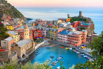 Wall Mural - Aerial view of Vernazza fishing village at sunset, seascape in Five lands, Cinque Terre National Park, Liguria, Italy.