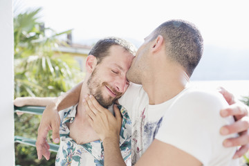 Tender kiss of a gay couple in love