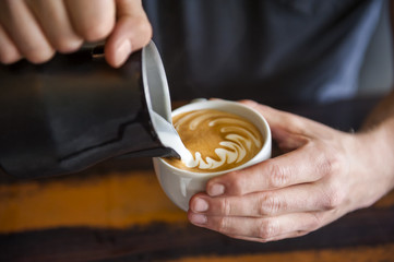 Barista preparing cappuccino in a cafe