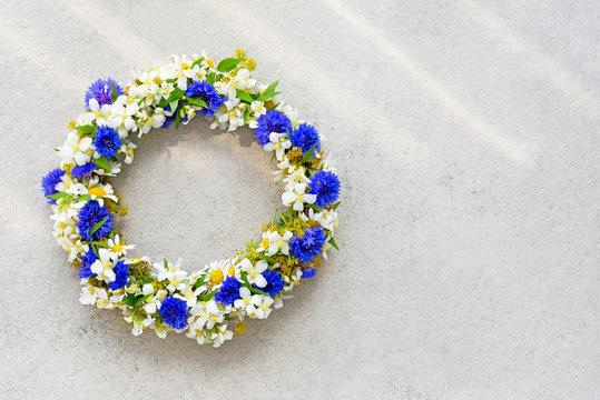 Floral wreath on concrete background.