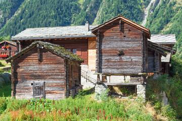 Sun-burnt wooden chalets  in Valais, tradition swiss  .Alps village Blatten-Belalp