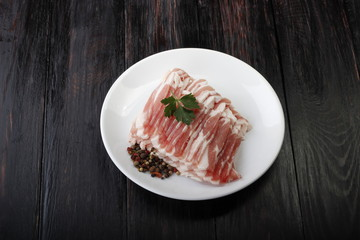 bacon on wooden background