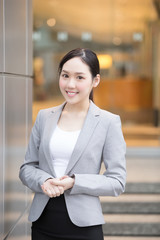 businesswoman is smile happily in the hon kong, asian