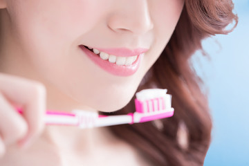 Beautiful woman holding tooth brush