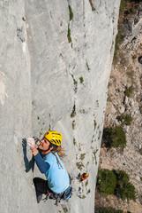 Climber climbing on the rock.