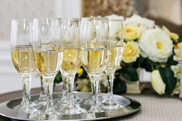 many of the champagne glasses on the table