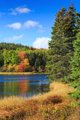 Fall foliage along the Trout River in rural Prince Edward Island, Canada.