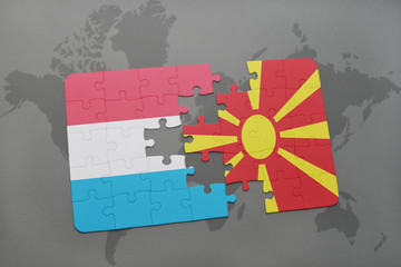 puzzle with the national flag of luxembourg and macedonia on a world map background.