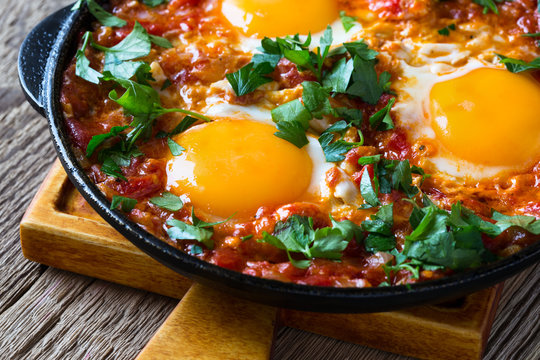 Egg dish with tomato sauce  served in  cast iron pan, shakshouka