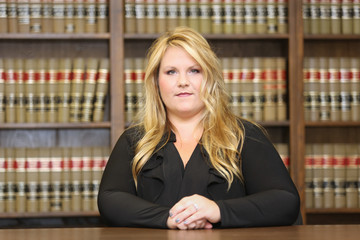 Young attractive female professional, female attorney in law library
