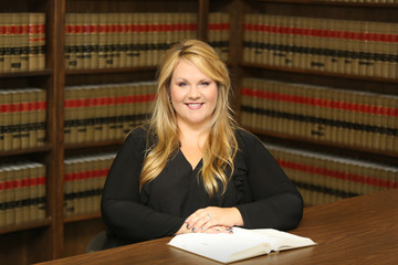 Young attractive female professional, woman lawyer in law library