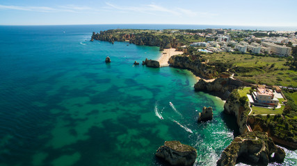 Beautiful ocean beach and cliffs in the south of Portugal, Lagos aerial view