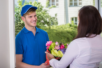 Woman Received Bouquet From Delivery Man