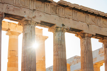 The Sun shines through the colonnade of the Parthenon in Athens, Greece.