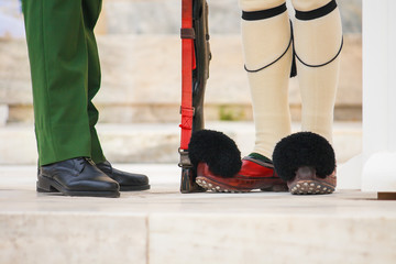 Close up image of an evzone's and main officer's feet during the traditional guard change on Syntagma square, Athens, Greece.