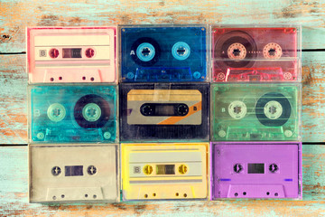 Top view (above) shot of retro tape cassette on wood table - vintage color effect styles.