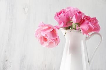 Pink roses in jug