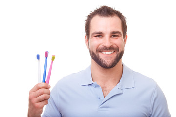 Young man with toothbrushes