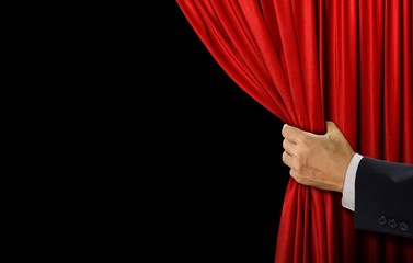 Hand open stage red curtain on black background Fototapete