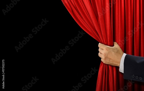 Hand open stage red curtain on black background Stock photo and