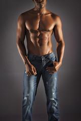 African male model wearing jeans.