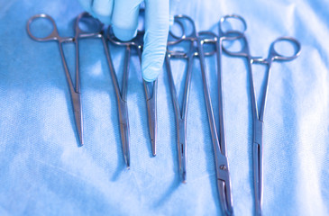 surgical instruments, laid out on an operating table