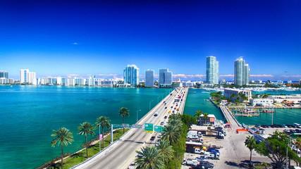 Wall Murals Dark blue MacArthur Causeway and Miami skyline from the air