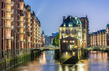 Hamburg, Germany - Popular Water Castle at night in the warehous