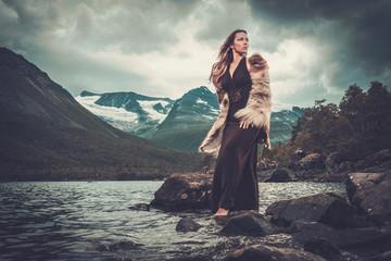 Nordic goddess in ritual garment near wild mountain lake in Innerdalen valley. Wall mural