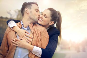 In love man kissing his girlfriend