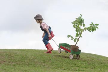 planting park bonding child grandfather family togetherness eco