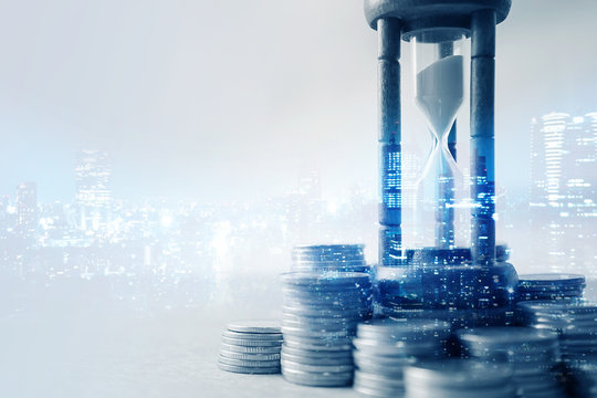 Double exposure of coin money and hourglass for about time of finance concept