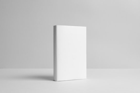 Hardcover Book Mock-Up - Dust Jacket. Wall Background