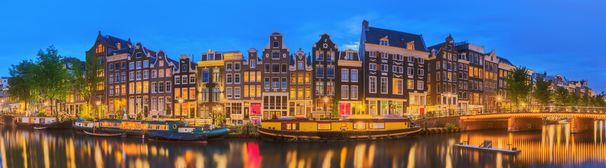 Aluminium Prints Amsterdam Amstel river, canals and night view of beautiful Amsterdam city. Netherlands