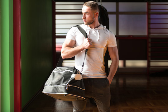 Young man with sports bag
