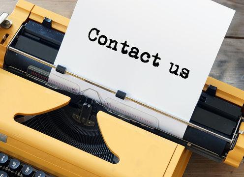 Contact us - yellow typewriter