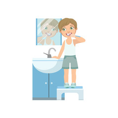 Boy Brushing The Teeth In Front Of Mirror