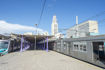 Empty commuter train platform at Central do Brasil train station with its famous clock tower in Rio de Janeiro, Brazil