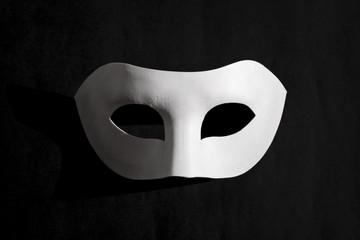 White Venetian mask with black background