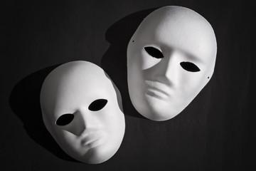 White Venetian mask and black background