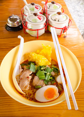bowl of  delicious noodles with vegetables and boiled egg on woo