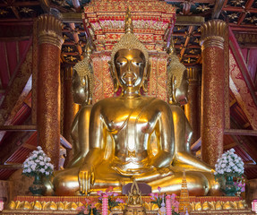 Golden Buddha statue is squat