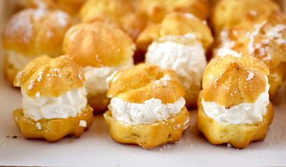 Cream puff cakes with whipped cream