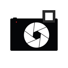 Black compact Camera with flash and open aperture
