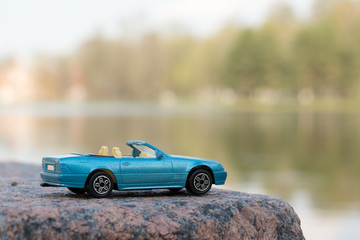 Blue Car against Water Background