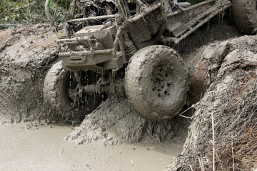 Muddy Wheels of Off-road vehicle driving out of mud on 4x4 Car-race