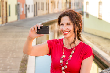 woman taking selfie over canals