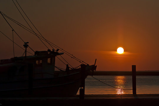 Fishing boat tied to the dock on the Apalachicola River at sunrise