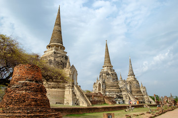 Temple ancient white grey pagoda place of worship famous in wat phra sri sanphet,ayutthaya, thailand